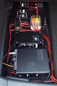 "Clockwise from bottom: VHF/UHF digital transceiver, ""Super Booster,"" low current fuse box, APO3 (x2), 120A relay, high current fuse block, ground block."