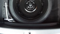 The stock GTI trim panel for donut spare tire...