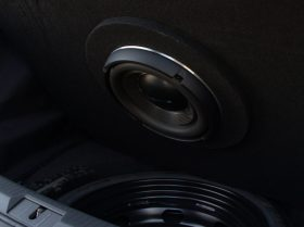 "There is nearly 2-1/2 inches of clearance between the highest point of this ""bolt"" and the mounting face of the subwoofer. The metal trim ring extends less than 1.5″. In short, there is over an inch of clearance between the bolt and the static subwoofer."
