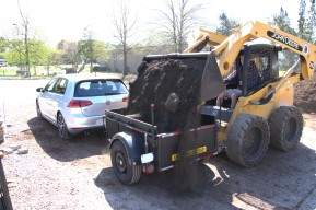 1/2 cubic yard of soil weighs ~1000 lbs...