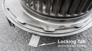 Pull this locking tab to allow rotation of the blower for removal...