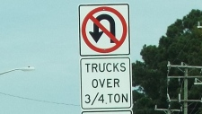 This sign does not apply to me, even with the trailer in tow. I can cut a U-turn on any three-lane road or a two-lane road with shoulders. I can also do a three-point turnaround with the trailer...