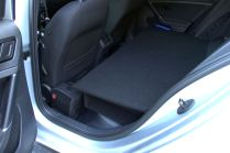 The extra few inches of door/floor also serve as retention for items riding behind the driver's seat...