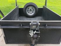 I like to carry my spare tire in the back for better trailer balance and easier hand-maneuvering...