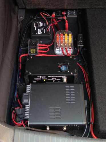 "Clockwise from bottom: VHF/UHF digital transceiver, ""Super Booster,"" low current fuse box, APO3, 120A relay, high current fuse block, ground block."